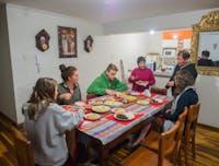 IVHQ volunteers dining in Cusco, Peru