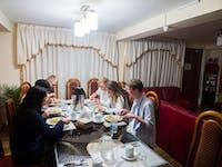 Volunteers dining in Cusco, Peru with IVHQ