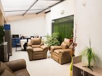 Volunteer living room in Cusco, Peru with IVHQ