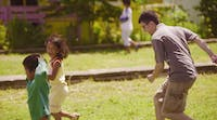 A volunteer chases children on the IVHQ Philippines childcare project
