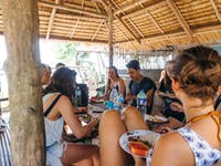 IVHQ volunteers enjoy a meal in the Philippines