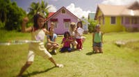 IVHQ volunteer plays with children in the Philippines