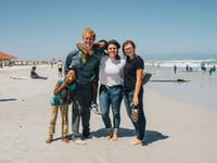 IVHQ volunteers on Muizenburg Beach in South Africa with IVHQ