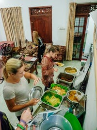 IVHQ volunteers serving dinner in Kandy, Sri Lanka