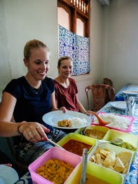IVHQ volunteers serving Lunch in Kandy, Sri Lanka