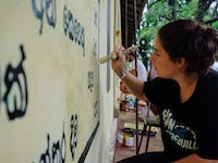 Temple Renovation volunteer painting in Sri Lanka