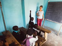 A childcare volunteer working in Tanzania with IVHQ