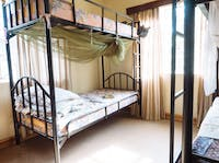 A typical homestay bedroom in Tanzania