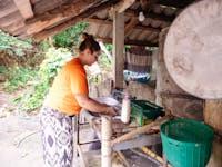 IVHQ Thailand volunteer washing up after dinner