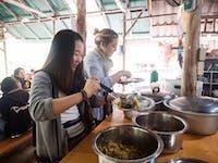 IVHQ Thailand volunteers serving Dinner