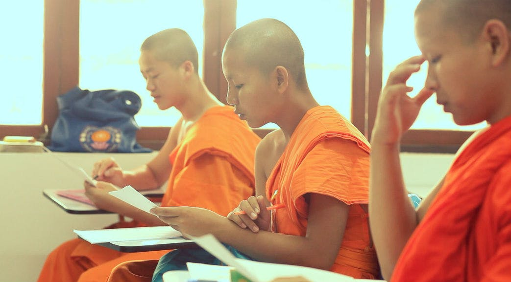 Volunteers teaching monks in Thailand