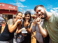 IVHQ volunteers try the local snacks in Uganda