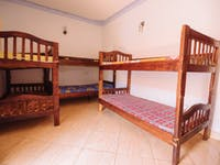 Volunteer bedroom in Uganda with IVHQ