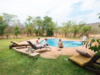 Volunteer pool in Victoria Falls with IVHQ