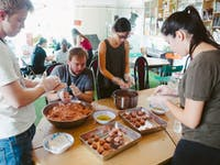 Volunteers preparing food on the Food Outreach volunteers with IVHQ in Vietnam