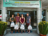 Group of volunteers on the Food Outreach volunteers with IVHQ in Vietnam