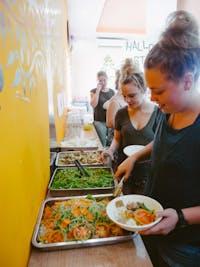 IVHQ volunteers serving food in Vietnam