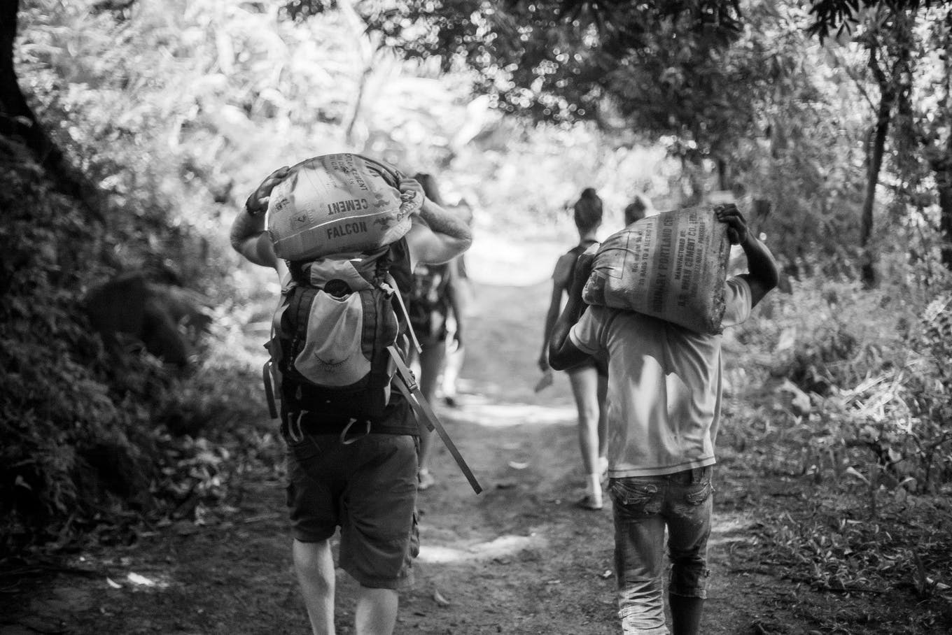 construction volunteer in Madagascar carrying cement