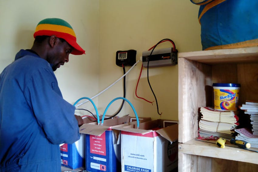 Installing a new solar panel in Tanzania with IVHQ