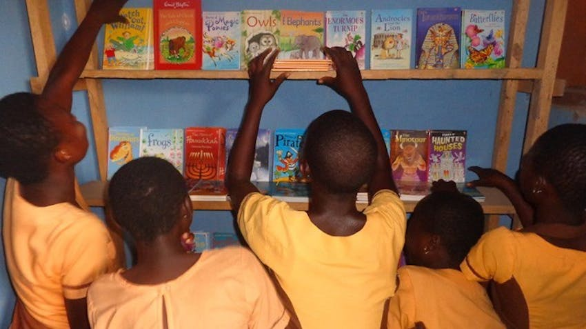 Children checking out the donated books